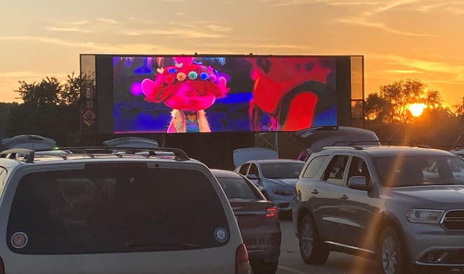 A rendering shows a proposed drive-in movie space in the parking lot of Valley West Mall.