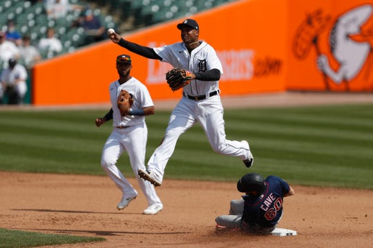 Detroit Tigers second baseman Jonathan Schoop (7) marks the bag for another base and skips Minnesota Twins center filters Jake Cave (60) to throw to first base during the fourth inning on April 6, 2021 at Comerica Park.