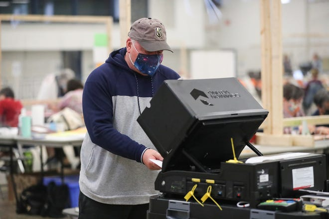 Fond du Lac resident Joseph Dumbaskas enters his ballot in the spring local general election Tuesday at Fond du Lac County Fairgrounds.