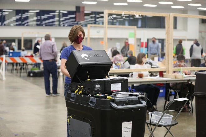 Volunteer Dusty Krikau enters absentee ballots in the spring local general elections Tuesday at the Fond du Lac County Fairgrounds. A higher voter turnout is expected today, especially in the city where voters will decide a public safety referendum to add more police and firefighters.