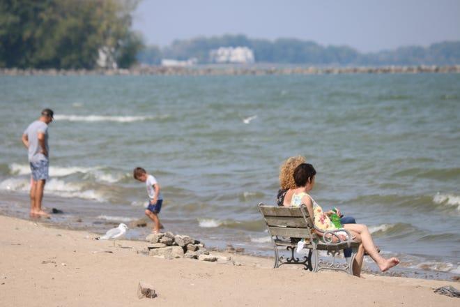 Beach goers embrace the warmer weather along the Lake Erie coast near downtown Port Clinton.