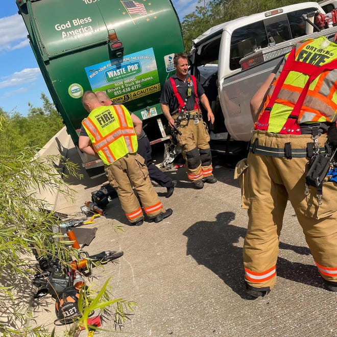 Fort Myers Fire Department extricated a driver of a pick up truck who was pinned inside after crashing with a garbage truck on Tuesday, April 6, 2021.