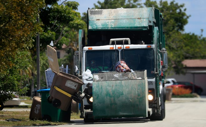 A Waste Pro garbage truck collects trash along a neighborhood south of Cape Coral Parkway Monday, April 5, 2021. Cape Coral residents have been upset with their trash not being picked up.