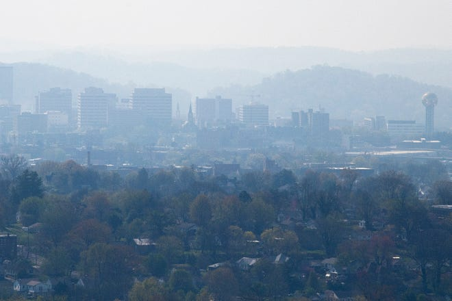 Smoke causes a haze over the Knoxville skyline, as seen from Sharps Ridge on Tuesday, April 6, 2021.