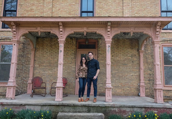 Dave and Brittany Rademacher, pictured Tuesday, April  6, 2021, are restoring this late 1800's Italianate-style farmhouse in Eaton County while living in it.