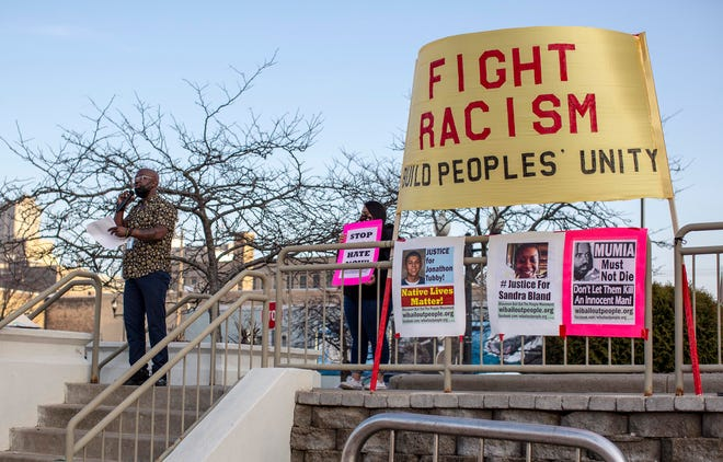 Crusaders of Justicia's Aaron Bailey speaks during the rally near city hall honoring the legacy of Dr. Martin Luther King, Jr., Monday, April 5, 2021, in Manitowoc, Wis. King was assassinated April 4, 1968 in Memphis, Tenn.