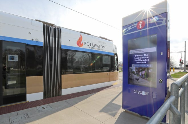 A two-sided kiosk is seen at a Milwaukee streetcar platform at the intersection of Ogden and Prospect in Milwaukee. The two-sided kiosks from Smart City Media will be on streetcar platforms or near the 2.1-mile route that runs in a loop through eastern downtown to the edge of the Historic Third Ward. The kiosks have 55-inch interactive touch screens that will feature content in multiple languages to help users navigate the transit system and the city and find information including community calendars, business directories and more, according to a statement from the city. The screens will also show arrival times for the streetcar, advertising and other local content when they're not in use.