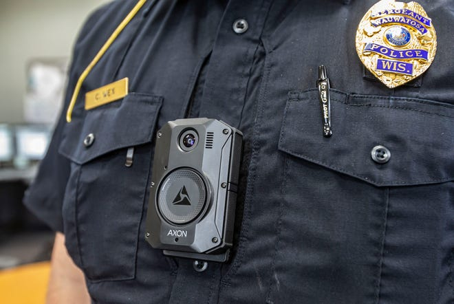 Sergeant Wex of the Wauwatosa Police Department shows a common center mount position of the Axon body camera as seen on Tuesday, April 6, 2021. The camera is activated by the officer and will record audio and video. Waukesha and New Berlin are working toward implementing similar Axon body cameras in the months ahead.