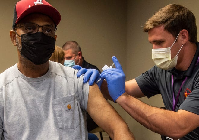 James Milliard receives his vaccination at the COVID-19 vaccination clinic inside the Baptist Health Medical Center in Prattville, Ala., on Tuesday, April 6, 2021.
