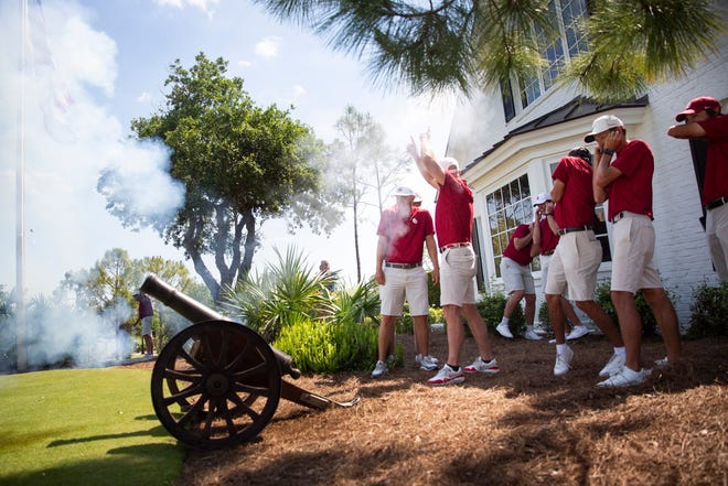 The Oklahoma University golf team celebrates winning the inaugural Calusa Cup college golf tournament by shooting off a cannon at Calusa Pines Golf Club in Naples on Tuesday, April 6, 2021.