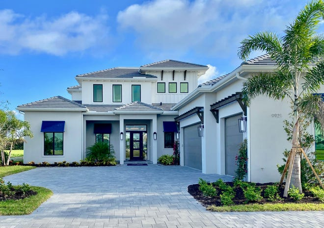 Imperial Homes' two-story Domenica II model in Peninsula Treviso Bay overlooks a lake to the TPC golf course on the other side.