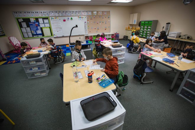 Students sit in class at Hillrise Elementary School on the first day of in-person schooling in Las Cruces on Tuesday, April 6, 2021.