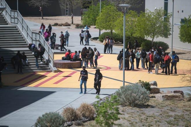 Students eat lunch and have a break at Centennial High School on the first day of in-person schooling in Las Cruces on Tuesday, April 6, 2021.