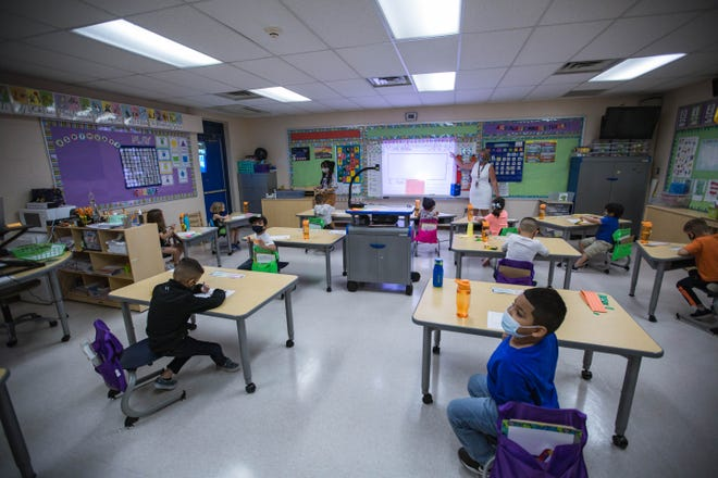 Students sit in their classroom at Hillrise Elementary School on the first day of in-person schooling in Las Cruces on Tuesday, April 6, 2021.