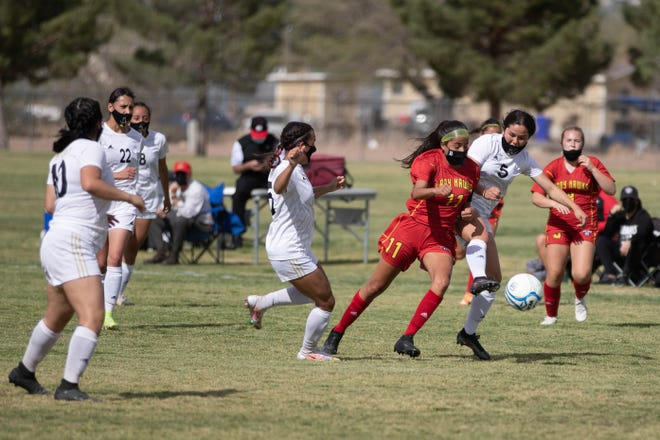 Jennifer Enriquez (11) dribbles foward with the ball as the Centennial Hawks face off against the Hobbs Eagles in state tournament quarterfinals at the Field of Dreams in Las Cruces on Tuesday, April 6, 2021.