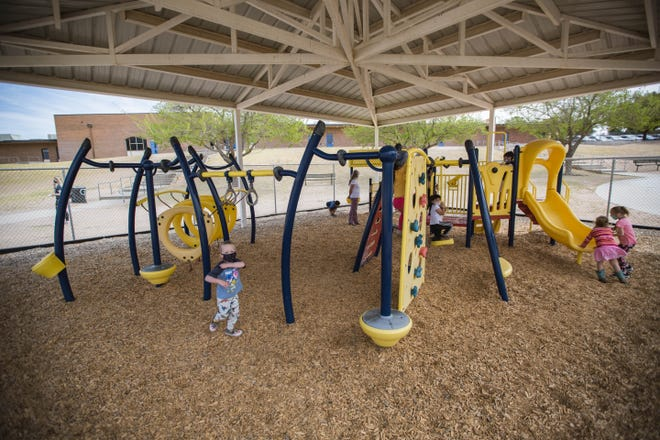 Pre-K kids play on the playground at Hillrise Elementary School on the first day of in-person schooling in Las Cruces on Tuesday, April 6, 2021.