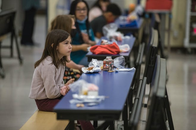 Students eat lunch at Hillrise Elementary School on the first day of in-person schooling in Las Cruces on Tuesday, April 6, 2021.