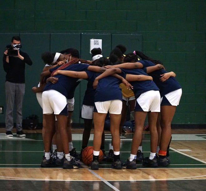The Wayne Zebras huddle up before the game.