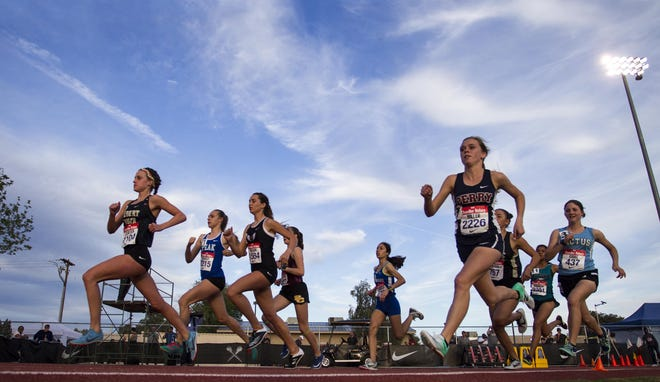 High School girls take the turn during the mile run in the 79th Annual Nike Chandler Rotary Invitational  March 23, 2019.