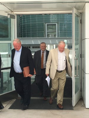 Backpage.com founders James Larkin (left) and Michael Lacey (right) as they leave federal court in Phoenix on April 30, 2018.