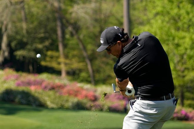 Phil Mickelson hits his tee shot on the 12th hole during a practice round for the Masters golf tournament on Tuesday, April 6, 2021, in Augusta, Ga. (AP Photo/Charlie Riedel)