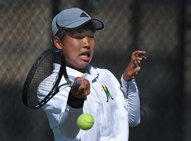 Bishop Manogue's Masato Kato hits a forehand to Reno opponent AJ Avansino during the boys tennis championship action at Bishop Manogue High School on April 5, 2021.
