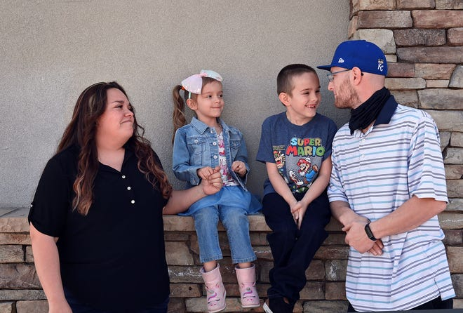 A portrait photo of the Fraley family hanging out outside on April 6, 2021. (From the left is Maria Fraley, Kylie Fraley, 4, Kolin Fraley, 7, and Chris Fraley.