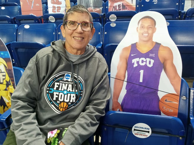 Retired RCS librarian Jane Moss with former Seton Catholic basketball star Desmond Bane's cardboard cutout at the NCAA men's basketball tournament in Indianapolis.