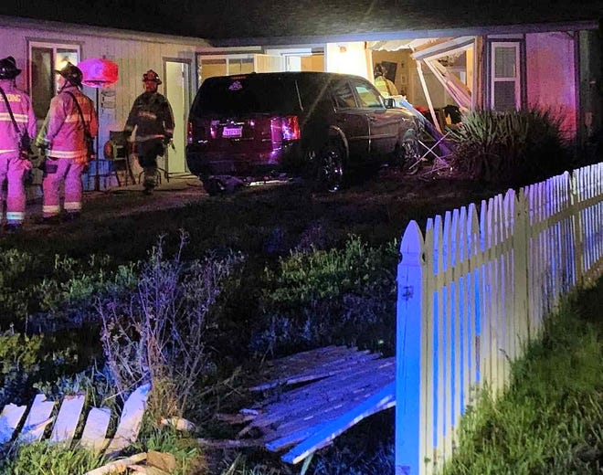 Redding police said 27-year-old Cody Burgarin drove a Honda Pilot into this home in the 3500 block of Capricorn Way after pouring gas inside the residence and trying to set it on fire on Tuesday, April 6, 2021.