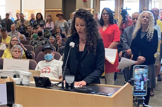 Elissa McEuen reads a statement to the Shasta County Board of Supervisors of the intent to recall three members: Leonard Moty, Mary Rickert and Joe Chimenti.