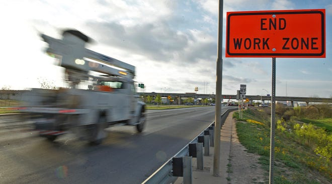 Traffic moves past a road construction work zone on N. Bryant Blvd. on Tuesday, April 6, 2021.