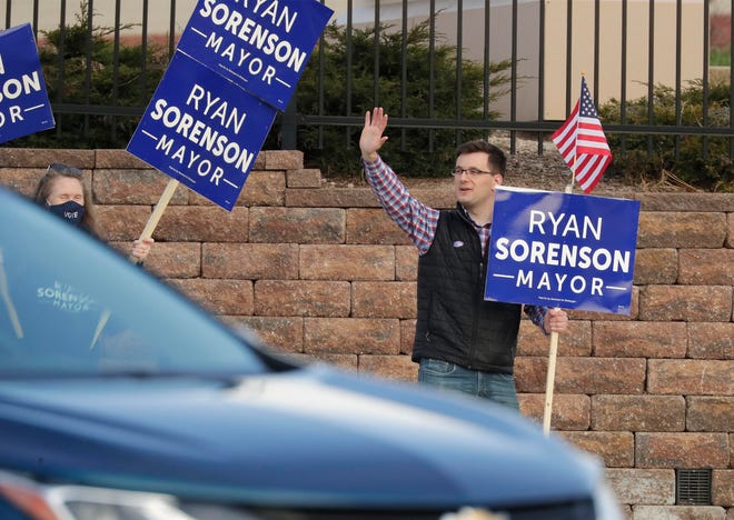 Mayoral challenger Ryan Sorenson waves from 14th and Erie Avenue, Tuesday, April 6, 2021, in Sheboygan, Wis.
