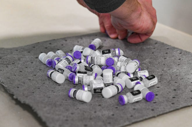 Frosty vials of the Pfizer COVID-19 vaccine rest on a table after being removed from the temperature-controlled package they were delivered in on Tuesday, April 6, 2021, at Sanford Imagenetics in Sioux Falls.