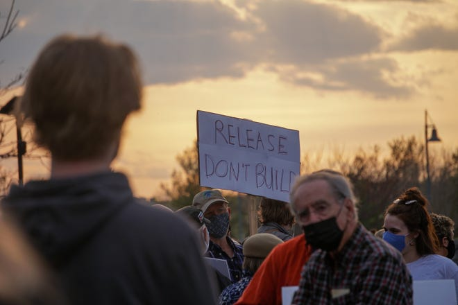 """""""Release, Don't Build,"""" one of many signs at the rally held at the Middle River Regional Jail"""