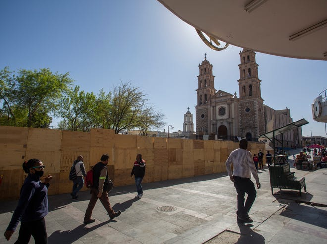 Marie Martine and her husband Fanfan Jean, walk around downtown Ciudad Juarez in search of a belt and shoe laces. U.S. Customs and Border Protection had taken the shoelaces from the migrants when they attempted to enter the U.S. without documentation.