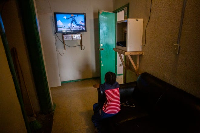 A Haitian child who recently arrived from Tijuana watches cartoons. The child and his parents attempted to enter the U.S. that night but were returned and decided to return to Tijuana, Baja California.