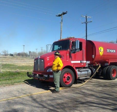 Friberg-Cooper VFD Lt. Ron Bakkenwith the department's new water tender truck.