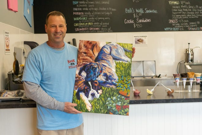 Richard Eckels shares a painting of his frozen custard shop's namesake, Hank and Stella, in the  Thornville shop. A new location of Hank & Stella's will open in South Zanesville next month.