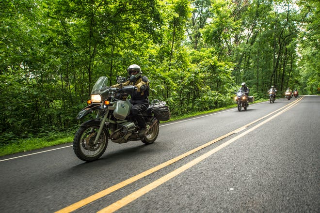 Twisting through the Ozark National Forest on Arkansas State Highway 23, the Pig Trail Scenic Byway takes riders through curves and climbs and under canopies of trees.