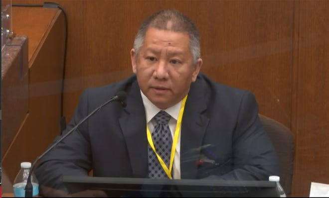 In this image from video, Minneapolis Police Crisis Intervention Coordinator Ker Yang testifies as Hennepin County Judge Peter Cahill presides Tuesday, April 6, 2021.