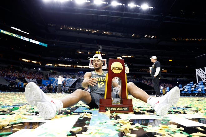 Jared Butler, the Final Four's Most Outstanding Player, enjoys the spoils of Baylor's first national championship.