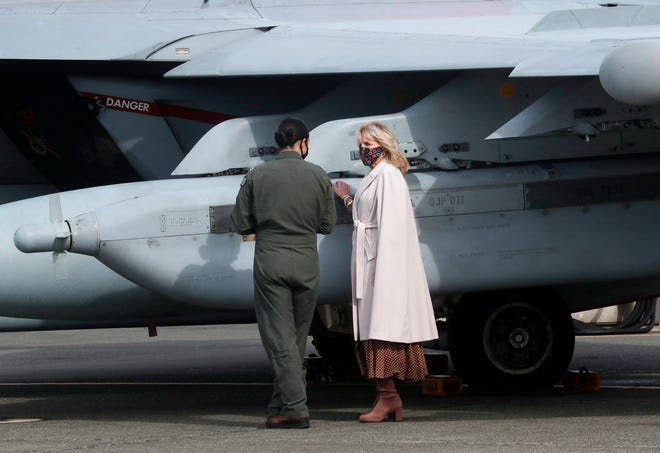 First lady Jill Biden gets a tour of a Growler aircraft by Naval Aviator Lt. Cate Oakley, March 9, 2021, at Naval Air Station Whidbey Island in Oak Harbor, Wash.