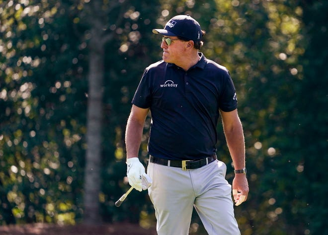 Phil Mickelson plays in a practice round Tuesday as he tries to win his fourth Masters.