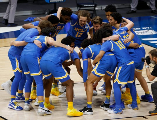 UCLA Bruins gather before taking off in the first round of the 2021 NCAA Tournament on Saturday, March 20, 2021 at Hinkle Fieldhouse in Indianapolis.