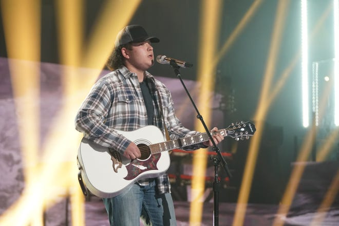 """Caleb Kenney plays guitar while performing The Allman Brothers' """"Midnight Rider."""""""