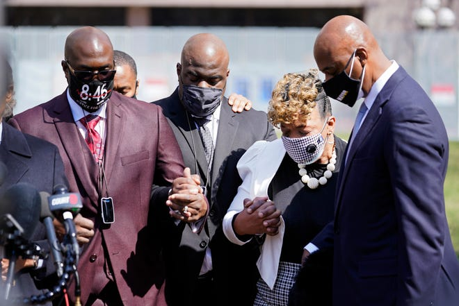 Philonise Floyd, left, the brother of George Floyd and other family members along with Gwen Carr, the mother of Eric Garner, take part in a prayer vigil led by the Rev. Al Sharpton outside the Hennepin County Government Center during lunch break Tuesday, April 6, 2021, in Minneapolis where testimony continues in the trial of former Minneapolis police officer Derek Chauvin.