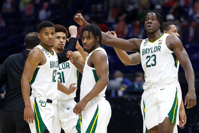 Jared Butler (No. 12), MaCio Teague (No. 31) and Davion Mitchell  (right, No. 45)  were keys to Baylor's title.