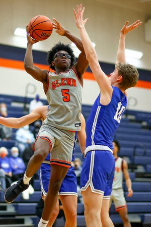 Glenn point guard Jaylen Thompson, shooting against Georgetown in February, has earned a spot on the American-Statesman All-Central Texas boys basketball team.