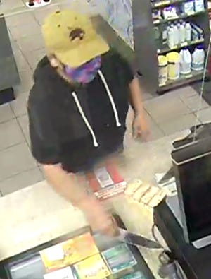 San Marcos police are searching for a woman who they said robbed a convenience store wielding a large kitchen knife on Monday. [COURTESY SAN MARCOS POLICE]