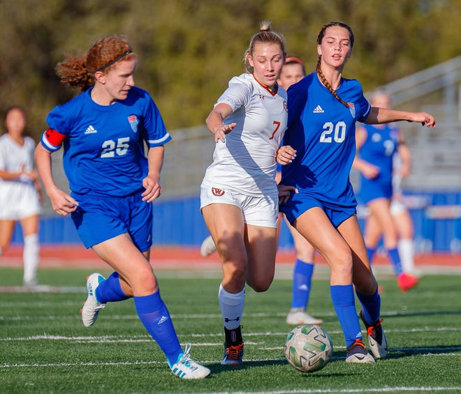 Westwood sophomore Skylar Zinnecker, center, competes for the ball against Westlake in a first-round playoff game in March. Zinnecker is among several talented players that will return next season for the Warriors.